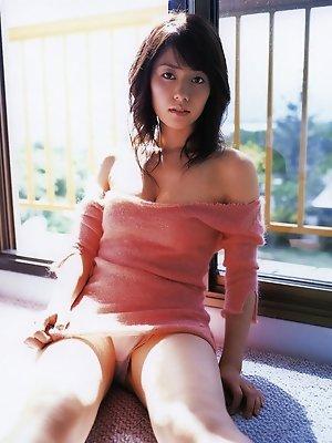 Beautiful gravure babe with soft plump boobs in a red bikini