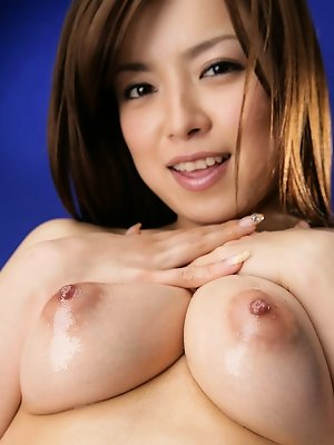Rei Asian fondles nasty tits with oil and exposes naughty behind