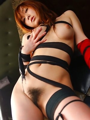 Yumi is a horny Asian slut who enjoys being tied up in knots for fucking and fun