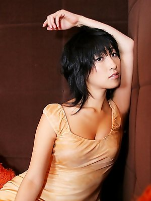 Alluring asian beauty intices with her big boobs and little dress