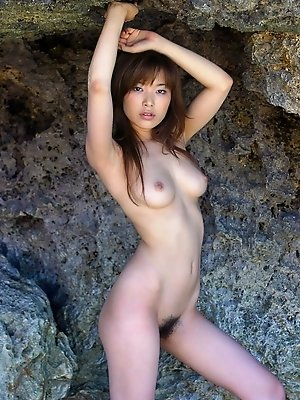 Lovely Asian beach bunny strips and shows her big tits and hot ass