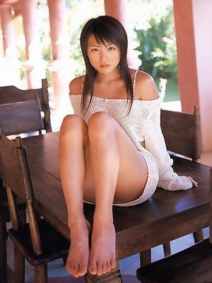 Petite cute little asian gravure model wearing an orange bikini
